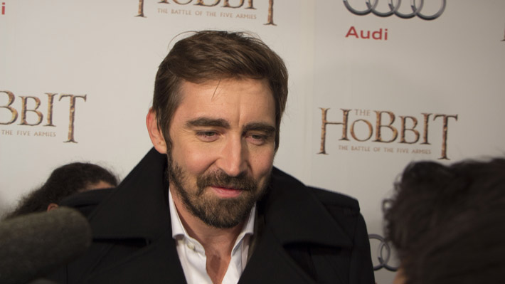 Lee Pace cheerfully jokes with some reporters on the Toronto Red Carpet