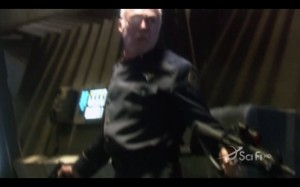 Everyone's favourite drunken, one-eyed, self-hating Cylon XO: Colonel Tigh dual wielding guns instead of whiskey bottles.