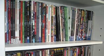Several shelves full of comic book trade paperbacks