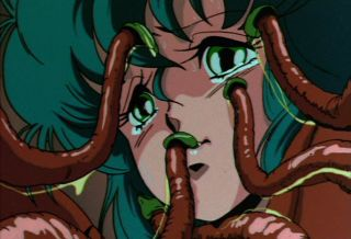 An animé woman has her face caressed by slimy tentacles.