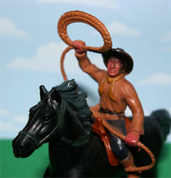 A toy cowboy with lasso.
