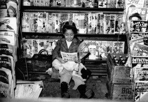 Girl reading comics via Getty Images