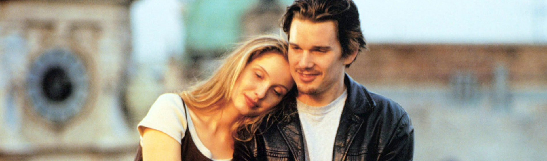 Julie Delpy leaning on Ethan Hawke's shoulder in Before Sunrise