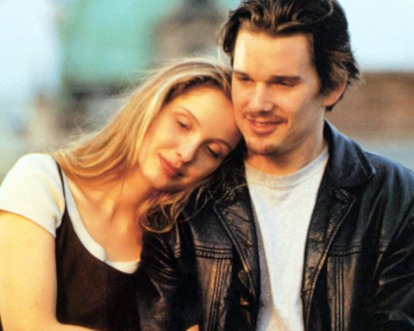 Julie Delpy leaning on Ethan Hawke's shoulder in Before Sunrise
