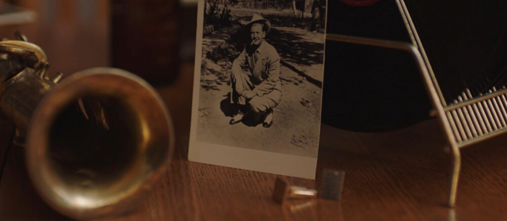 A photo of Billy Tipton sitting on a table in a still from No Ordinary Man