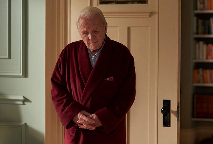 elderly man standing in room